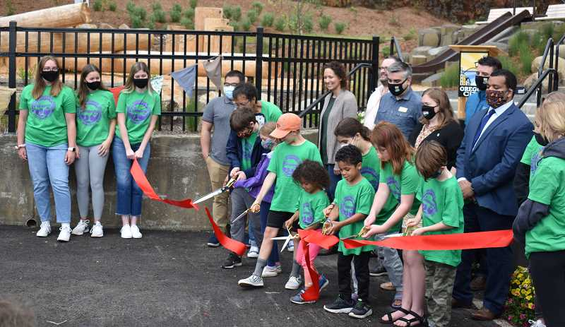 PMG PHOTO: RAYMOND RENDLEMAN - Girl Scouts, Oregon City and Metro officials help cut the ribbon at the June 5 event.
