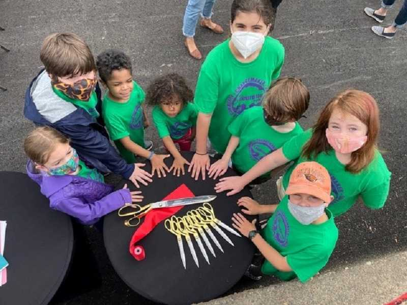 COURTESY PHOTO: CITY OF OREGON CITY - Many kids had a hand in cutting the ribbon at a newly revitalized Latourette Park.