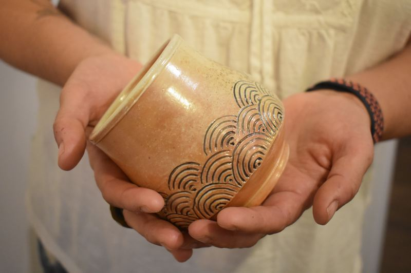PMG PHOTO: EMILY LINDSTRAND - A variety of wood-fired pottery mugs are included in Brenda Scott's show 'Hive' at the Spiral Gallery.