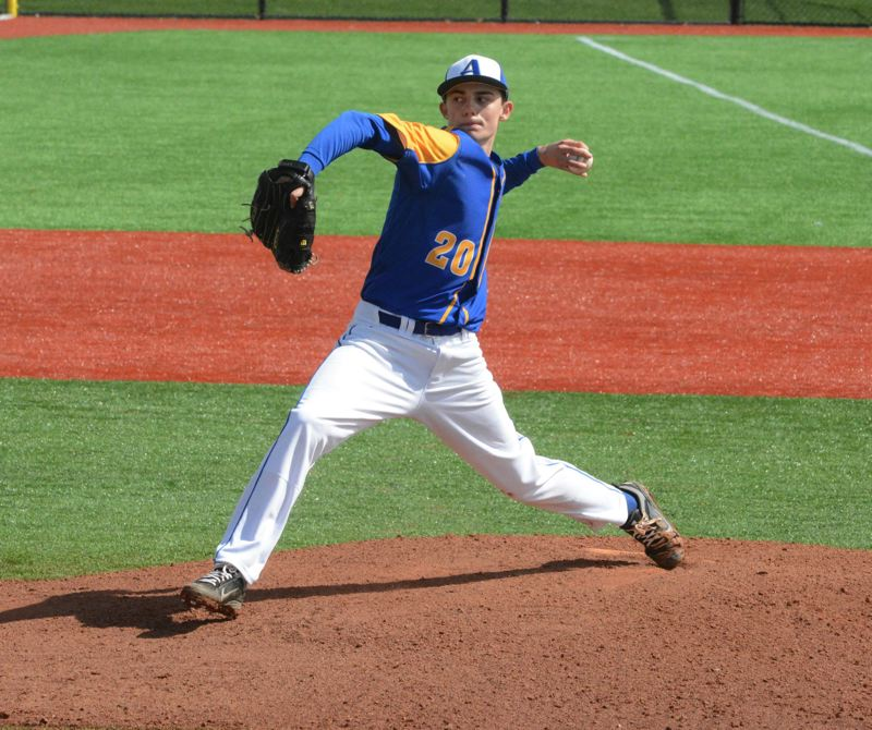 PMG FILE PHOTO - As a sophomore at Aloha High School, Brandon Eisert winds to fire a pitch in an April 2014 game against crosstown rival Beaverton at what is now called Ron Tonkin Field.