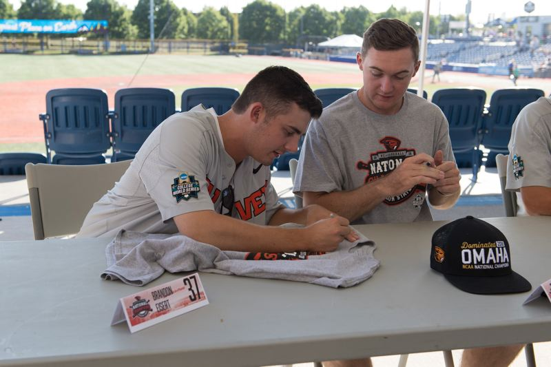 PMG FILE PHOTO - Oregon State baseball player Brandon Eisert signs a shirt before a Hillsboro Hops game at Ron Tonkin Field on July 16, 2018.