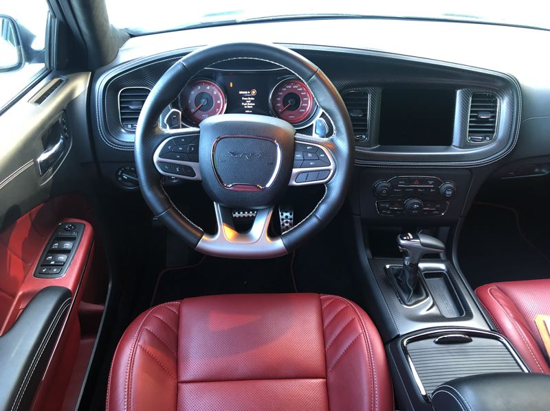 PMG PHOTO: JEFF ZURSCHMEIDE - Inside, the Redeye gets Dodge's best interior., including a touchscreen infotainment system, nice leather seats, air conditioning, and practically every available automotive technolgy.