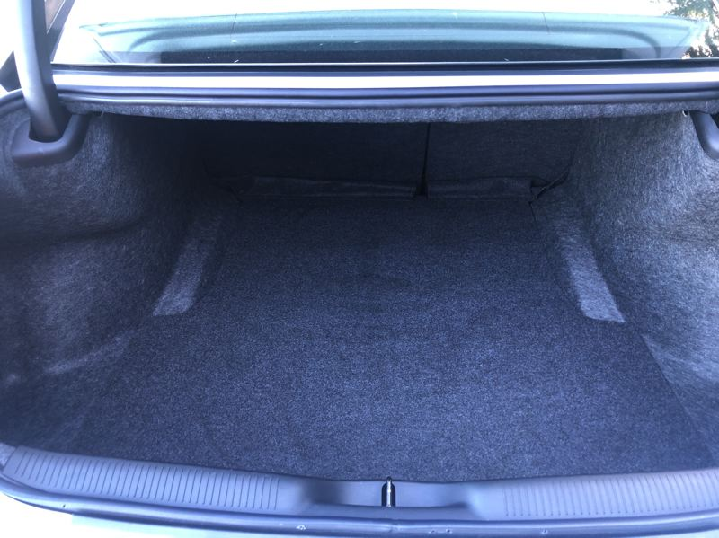 PMG PHOTO: JEFF ZURSCHMEIDE - The Charger trunk is big enough to hold all the luggage needed for long trips.