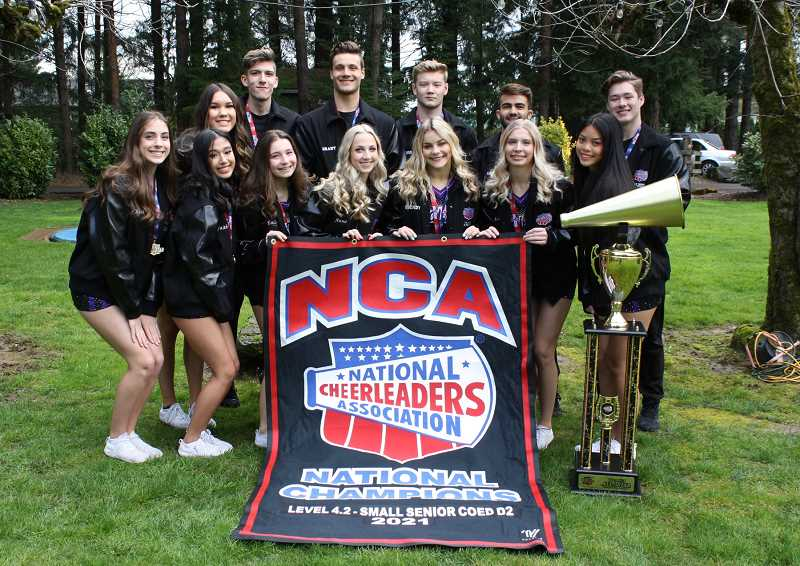 COURTESY PHOTO - Members of the Tualatin Cheer All-Stars pose for a photo with their NCA championship banner. Back row left to right: Jaiden Walczyk, Anthony Portscheller, Grant Heugly, Edward Stanton, Ian Ditlevsen, Jacob Duncan. Front row left to right: Maci Fidura, Faith Vu, Emily Kleps, Anna Giroux, Brendyn Riddle, Lacey Thurley, Estrella Sernande. Not pictured: Kevin Interian and assistant coaches Patty Mack and Andrew Knapp.