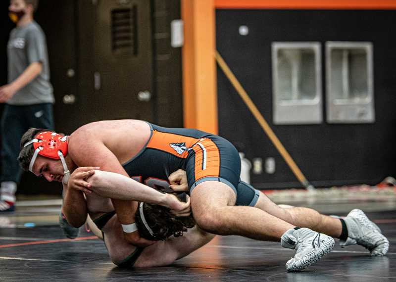 COURTESY PHOTO: JESSICA KAUFFMAN AND JOSI WELTER - At a Scappoose dual meet, Scappoose senior Brett Krieger wrestles an opponent from Rex Putnam High School.