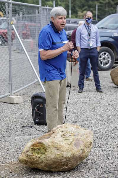 PMG PHOTO: JONATHAN HOUSE - Geology professor Dr. Scott Burns gives a short presentation about a 15,000-year-old rhyolite boulder unearthed on the school's grounds.