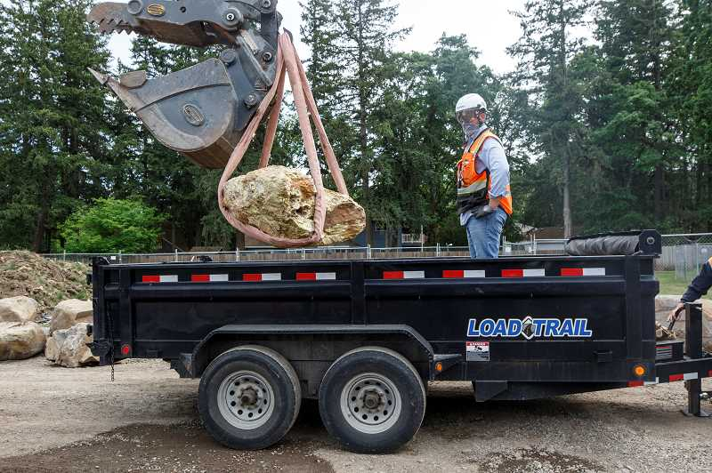 PMG PHOTO: JONATHAN HOUSE - Skanska Senior Site Superintendent Jacob Parker oversees the moving of the boulder unearthed at Lakeridge Middle School. The rock is now on display at the Tualatin Heritage Center.
