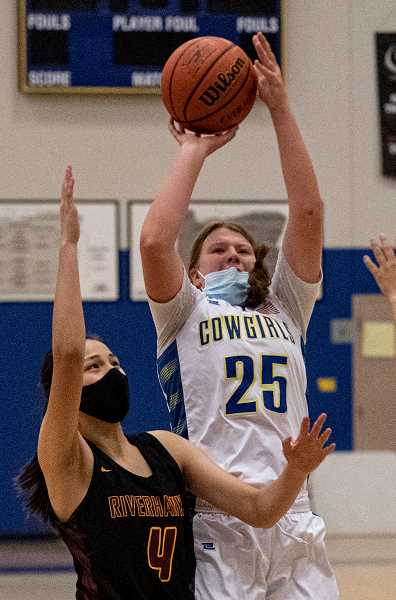 LON AUSTIN - Grace Brooks puts up a shot against The Dalles. Her 12 points led the team in scoring in the 52-17 win.