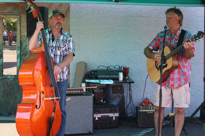 PAT KRUIS/ MADRAS PIONEER - Members of the group Countryfied perform during the First Thursday event in Madras June 3.