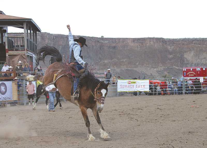 PAT KRUIS/MADRAS PIONEER  - More than 1,000 people attended the first Buckin' in the Canyon rodeo in Crooked River Ranch on Saturday.
