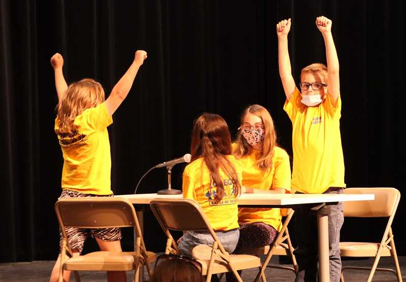 PHOTO COURTESY OF 509-J    - The Madras Elementary championship team celebrates during the Jefferson County Oregon Battle of the Books Championship last Wednesday. Pictured are James Noonan, Keira Moore, Adley Orlandos and Carson Moore.