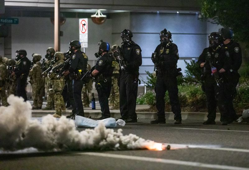PMG PHOTO: JONATHAN HOUSE - Federal agents during a protest in Portland on July 17, 2020. Less than two weeks earlier, a federal officer was struck in the eye by a laser outside the Mark O. Hatfield U.S. Courthouse, according to federal prosecutors.