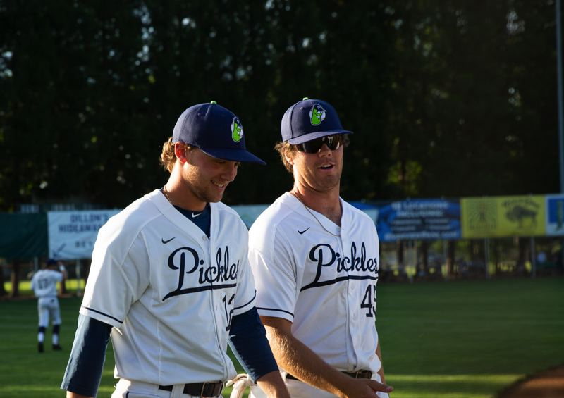 PMG PHOTO: ADAM WICKHAM - Gabe Skoro (left) shares a laugh with teammate Ryan Guardino before the Portland Pickles June 4 West Coast League opener. A Portland Pilots outfielder and Lincoln High grad, Skoro is in his fourth season with the Pickles.