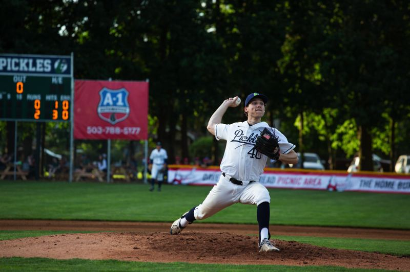 PMG PHOTO: ADAM WICKHAM - Lake Oswego High grad Alex Giroux, who now pitches for the University of San Diego, won the Pickles West Coast League opener on June 4.