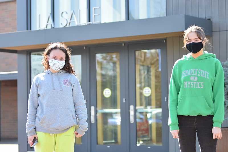 COURTESY PHOTO: LA SALLE PREP - Eastmoreland resident Maddie Khaw, left, and Happy Valley resident Carlie Weigel are the editors-in-chief of The La Salle Falconer.