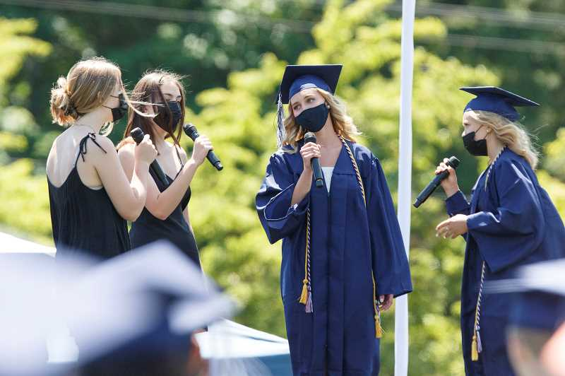 PMG PHOTO: JONATHAN HOUSE - The Dockside Dollies perform 'And So It Goes' at Lake Oswego High's graduation.