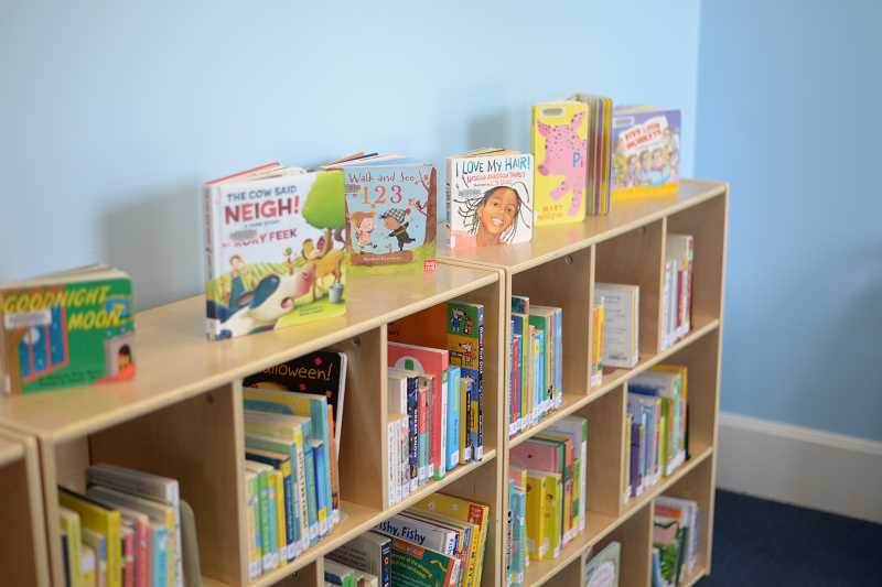 PMG PHOTO: ANNA DEL SAVIO - Children's books fill an alcove (and other spaces) in the Scappoose library.