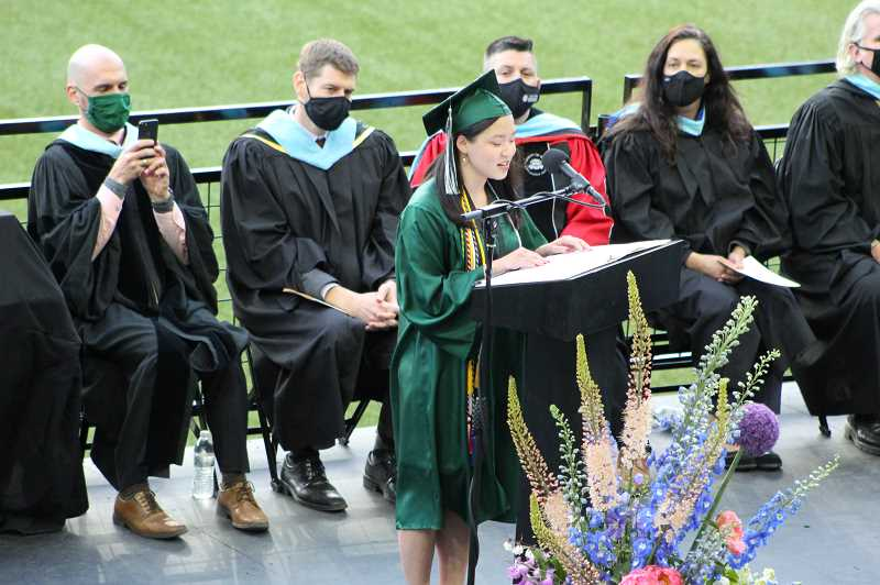 PMG PHOTO: COURTNEY VAUGHN - Mia Sedory speaks during the commencement ceremony for Ida B. Wells-Barnett High School held at Providence Park Monday, June 7.