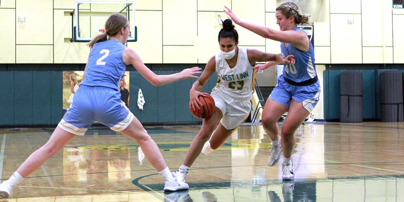 PMG PHOTO: MILES VANCE - West Linn's Campbell Sheffield drives during her team's 62-43 win over Lakeridge at West Linn High School on Wednesday, June 9.