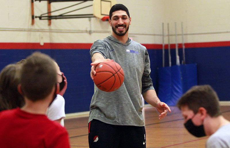 PMG PHOTO: MILES VANCE - Portland Trail Blazers center Enes Kanter jokes with youth basketball players at Lake Oswego Junior High School during a 90-minute clinic on Monday, June 7.