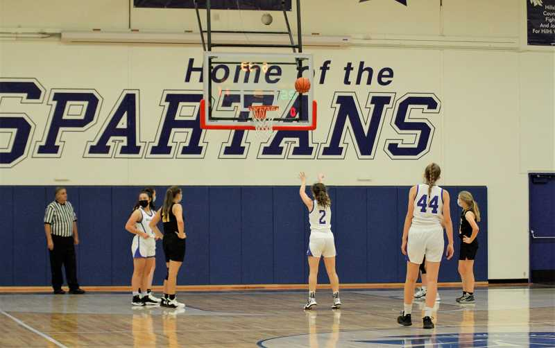 PMG PHOTO: WADE EVANSON - Hillsboro's Margaret Shively attempts a free throw during the Spartans 50-30 win over the Lions June 9, at Hillsboro High School.