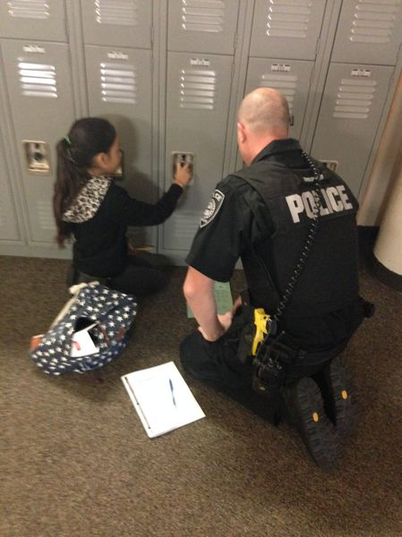 COURTESY PHOTO: GRESHAM POLICE DEPARTMENT - Gresham SROs help incoming sixth graders figure out how to open lockers.