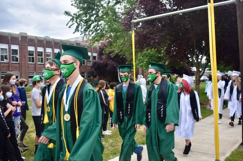 PMG PHOTO: EMILY LINDSTRAND - The Estacada High School class of 2021 walked past their former schools on Thursday, June 10.