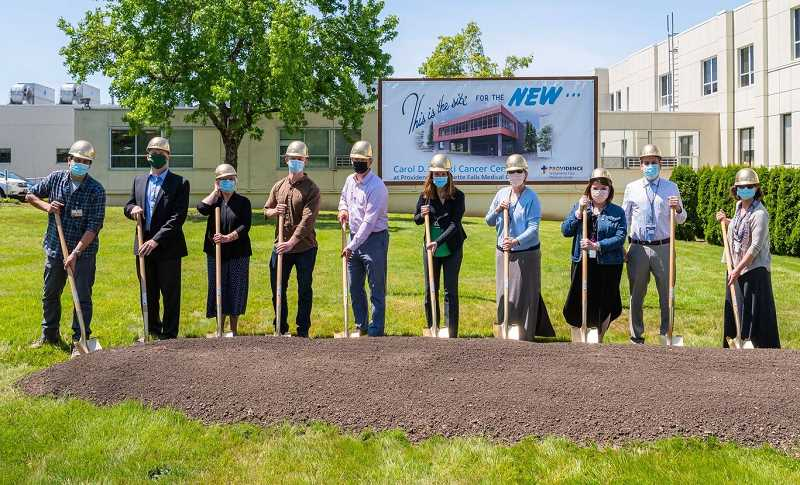 COURTESY PHOTO - Providence Willamette Falls and Providence Cancer Institute caregivers, Clackamas County community leaders, and representatives from PKA Architects and Fortis Construction gathered for a small groundbreaking ceremony May 26.