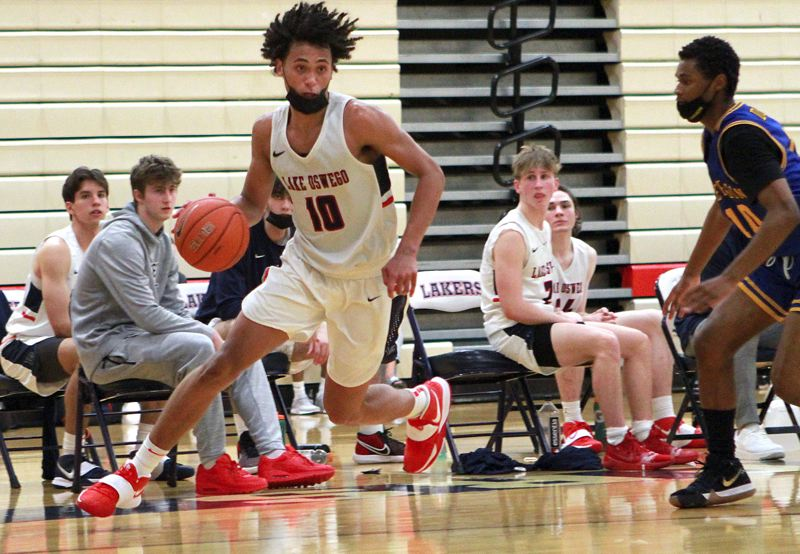 PMG FILE PHOTO - The pandemic-shortened and delayed 2021 basketball season will finish with a huge set of culminating week tournaments that will include the state's top Class 5A and 6A boys and girls basketball teams.