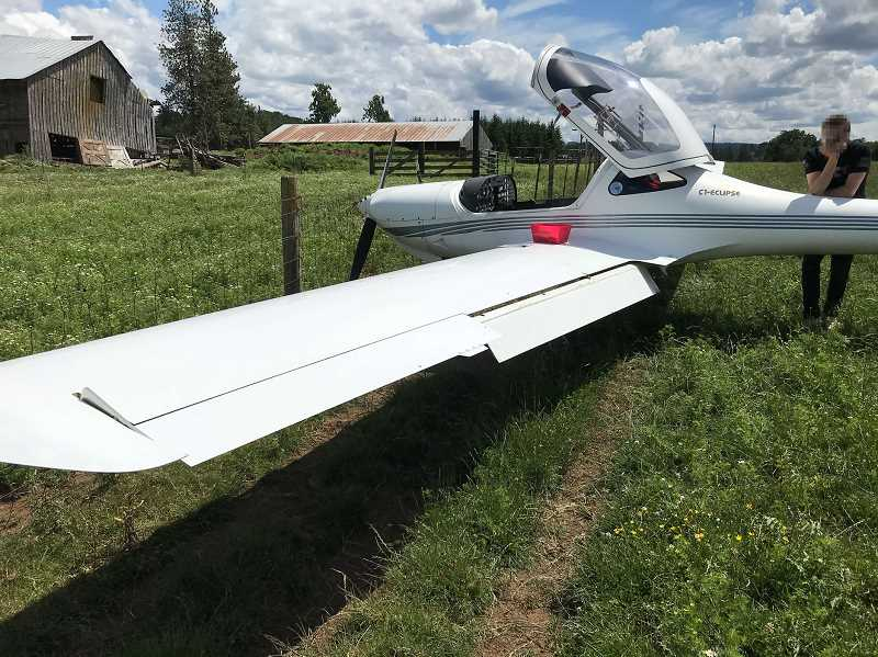 COURTESY PHOTO: CCSO - A Diamond DA21 C1 Eclipse comes to rest with its nose barely touching a fence in a pasture off South Feyrer Park Road near Molalla on Wednesday, June 9. The plane's pilot had safely performed an emergency landing.