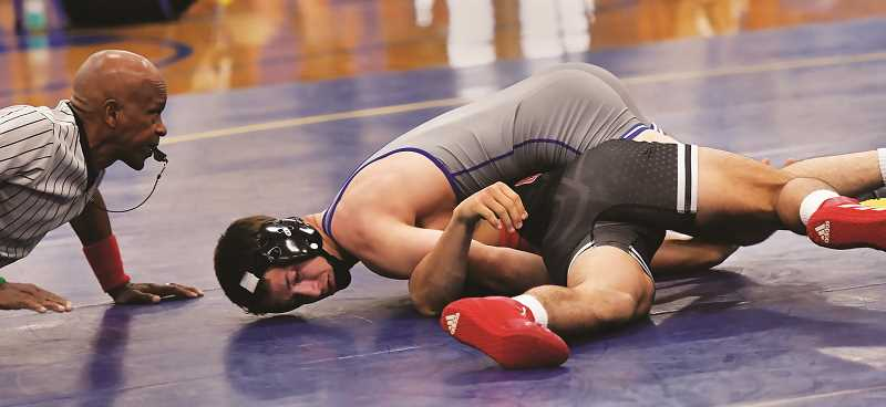 COURTESY PHOTO: DEAN TAKAHASHI - The defending state 6A state champion Tiger wrestling team has yet to lose a dual meet this season.