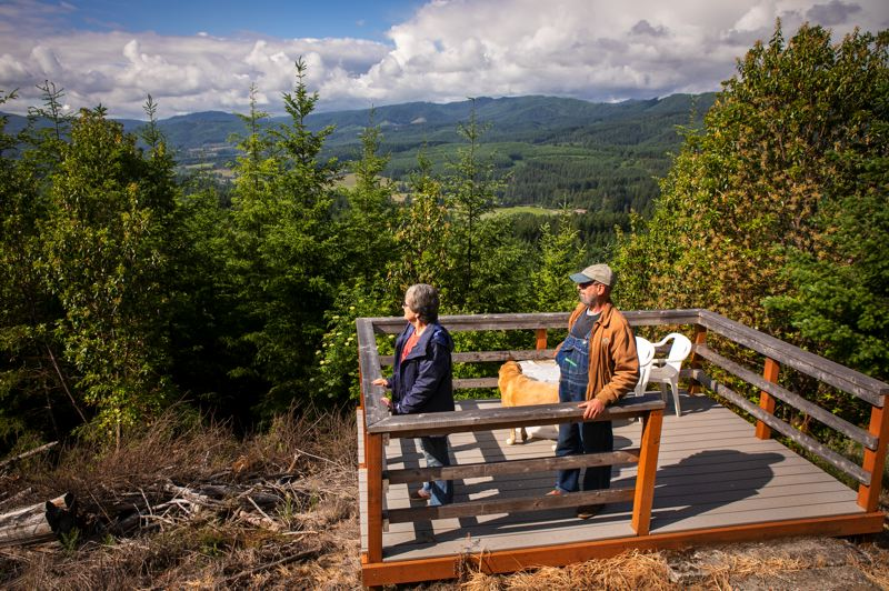 PMG PHOTO: JAIME VALDEZ - Bonnie and Bob Shumaker stand from a patio they made with a view from their tree farm on 'West 80' which indicates the 80 acres they acquired in 2017 near Banks.