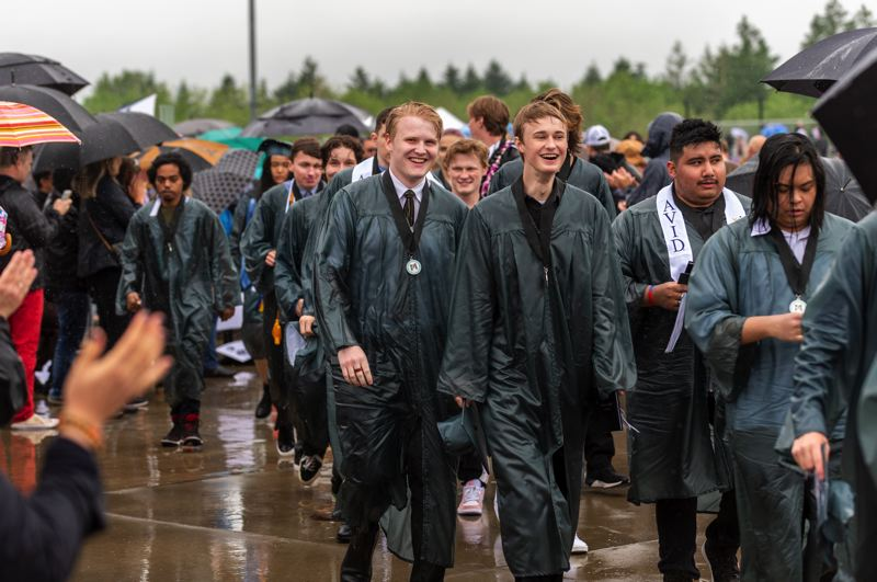 PMG PHOTO: DIEGO G. DIAZ - Graduates of Mountainside High School walk Sunday, June 13, after the school's first-ever full in-person graduation ceremony.