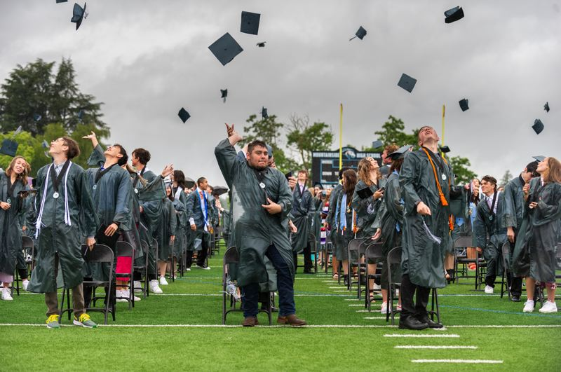 PMG PHOTO: DIEGO G. DIAZ - The Class of 2021 tosses their caps in the air at Mountainside High School's first-ever traditional graduation ceremony on the football field Sunday, June 13.