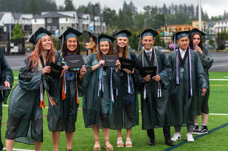 PMG PHOTO: DIEGO G. DIAZ - Mountainside High School graduates pose for pictures with their diplomas on Sunday, June 13.