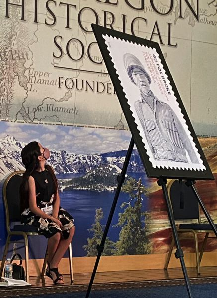 PMG PHOTO: DANA HAYNES - Mia Kazuko Ballinger, 11, of Bend, watches a video that honored her great grandfather and the other Nissei soldiers of Japanese heritage who fought in World War II. Mia was among the presenters at the Oregon Historical Society, Monday, June 14.