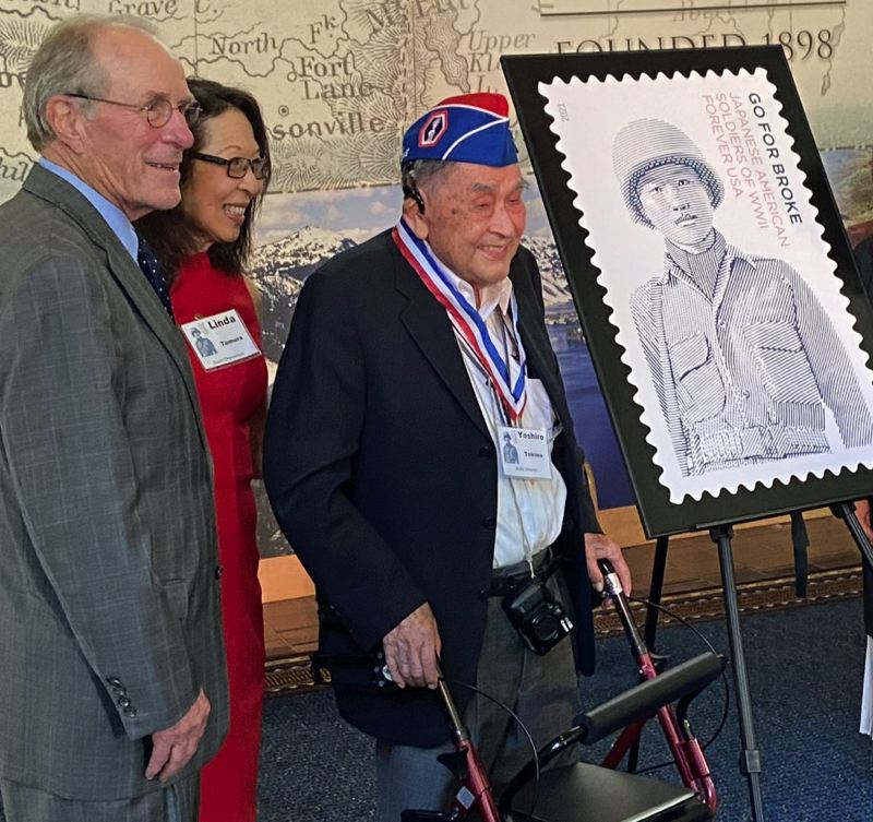 """PMG PHOTO: DANA HAYNES - Honoring the stamp that commemorates the """"Go For Broke"""" Nissei soldiers was, from left, former Oregon Gov. Ted Kulongoski, Linda Tamura, chair of committee organizing the event, and Yoshiro Tokiwa, one of the few surviving Nissei soldiers in the Portland metro area and a veteran of the 442nd Regimental Combat Team."""
