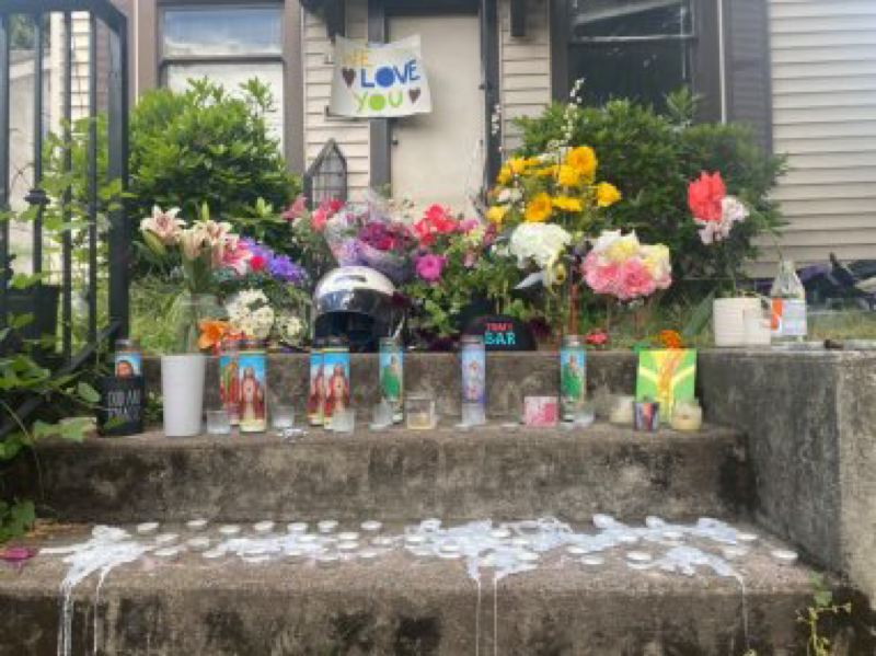 COURTESY PHOTO: KOIN 6 NEWS - A memorial has been set up outside of a house where four people were shot dead in Southeast Portland.