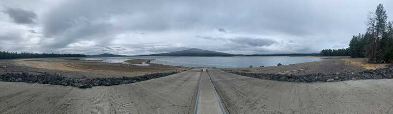 PHOTO COURTESY SETH MCLAUGHLIN   - Irrigation and releases for wildlife habitat have drawn the Wickiup Reservoir down to its lowest levels since irrigation began in 1946. The receding waterline reveals stumps of long dead trees.