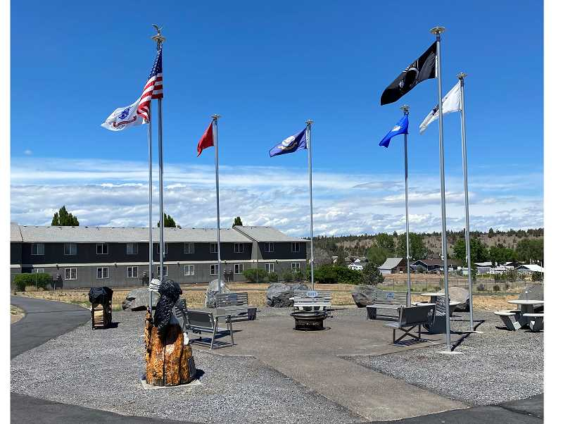PHOTO COURTESY OF SHAWN STANFILL   - Madras veteran Shawn Stanfill spearheaded the Veteran Healing Memorial efforts. The space, located on the Jefferson County Community Center grounds in Madras, features seven flagpoles, benches, picnic tables and a wooden eagle statue.