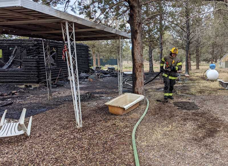 CROOKED RIVER RANCH FIRE AND RESCUE PHOTO   - Fire destroyed a two-story log home Monday, June 7 on Lords Place in Crooked River Ranch.