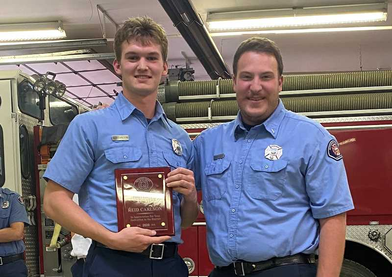PHOTO COURTESY OF JEFFERSON COUNTY FIRE DISTRICT NO. 1   - Jefferson County Fire District No. 1 Lieutenant Andrew Glen, right, presented the Firefighter of the Year award to Reid Carlson, left.