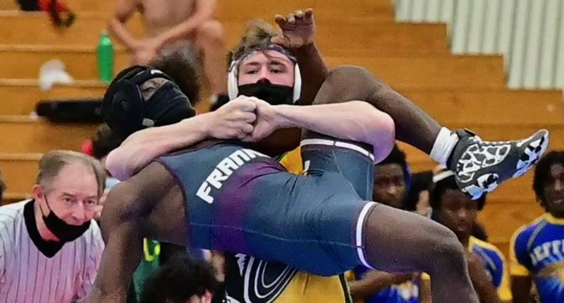 COURTESY PHOTO: LINDA JEO ZERBA - Cleveland sophomore Logan Medford was named outstanding wrestler of the PIL championship meet on June 12 at the Marshall campus. He beat Franklin's Kubyoo Amani by technical fal in this chamionship match at 126 pounds.