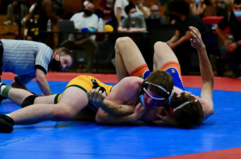 COURTESY PHOTO: LINDA JEO ZERBA - Cleveland sophomore Garrett Cappalonga (left) pinned Benson's Albert Rice on June 12 in the finals at 182 pounds during the PIL district wrestling championships.