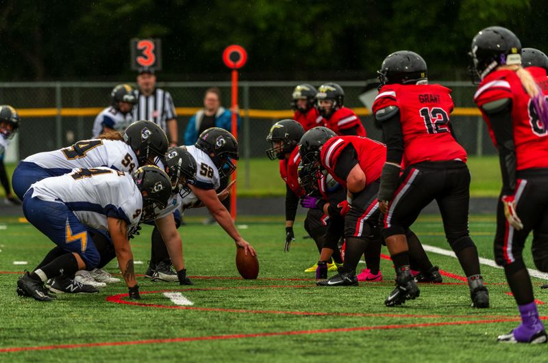 PMG PHOTO: DIEGO G. DIAZ - The team element of football is one of the attractions for the women of the Portland Fighting Shockwave, including Joeterika Grant (12).