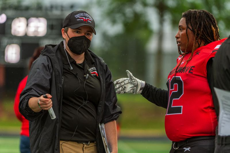 PMG PHOTO: DIEGO G. DIAZ - Coach Asia Wisecarver (left) and Joeterika Grant talk during the Portland Fighting Shockwave's June 12 game at Century High in Hillsboro.
