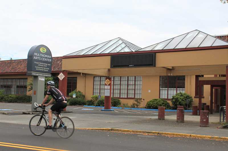 PMG FILE PHOTO - A cyclist rides past the Multnomah Arts Center building in Southwest Portland, where Southwest Neighborhoods Inc. leases space from the city of Portland. The district coalition sent a stern letter to city leaders saying a lawsuit could be forthcoming if the city doesn't restore the coalition's funding.