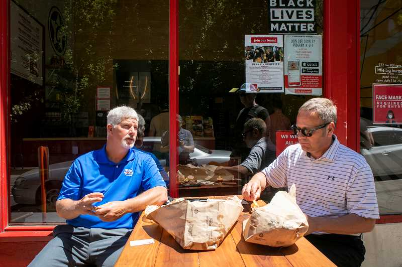 PAMPLIN MEDIA GROUP: JAIME VALDEZ - John Burrows (LEFT) and Michael Johnson outside at Little Big Burger on Northwest 10th Ave. The Pepsi reps eat in restaurants as part of their job and prefer sitting outside for the atmosphere.