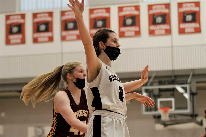 PMG PHOTO: WADE EVANSON - Sherwood's Ava Heiden posts up a Forest Grove defender during the two teams' game on Tuesday, June 15, at Sherwood High School. Heiden led the Bowmen with 13 points and 7 rebounds.