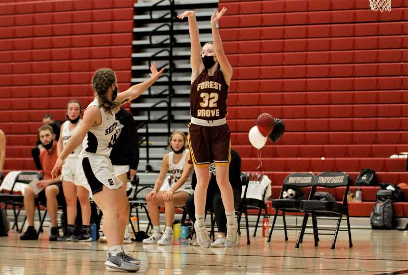 PMG PHOTO: WADE EVANSON - Forest Grove's Lauren Buchanan takes a three-point shot from the baseline during the Vikings' game against Sherwood Tuesday, June 15, at Sherwood High School.